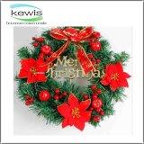 La decoración de la Navidad coloreó la guirnalda artificial de la Navidad de la guirnalda de la Navidad