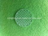 穴が付いている円形の明確な水晶ディスク