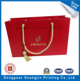 Qualitäts-rote Farben-Papier-Einkaufstasche mit goldenem Firmenzeichen