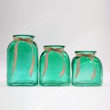 Vaso di vetro variopinto trasparente con il nastro della corda