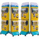 卵のおもちゃ機械Gashaponの自動販売機の硬貨によって作動させるおもちゃ機械