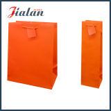 Sac de papier estampé par Pantone bon marché de logo fait sur commande orange de couleur