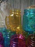 Tarro de masón del vidrio de consumición con la maneta