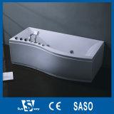 Bañera de esquina con el agua de la bomba de masaje