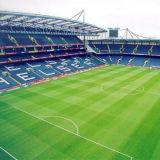 Het kunstmatige Gebied van /Soccer van de Voetbal van de Spelers van het Gras/van het Voetbal Field/7