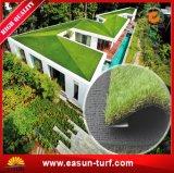 景色の庭の緑の総合的な草の人工的な草
