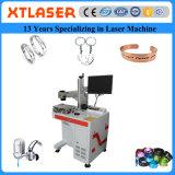 La machine d'inscription de laser de fibre de laser de Xt pour le collier en acier de boucles de mariage de bracelets d'en cuivre d'argent d'or de platine relâche les chaînes principales