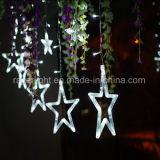 青いカラークリスマスLEDの星はクリスマスの休日の祝祭の装飾をつける