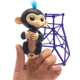 Le doigt de cadeau d'année neuve joue Noël de jouet de singe de Lling de doigts d'Interactivet pour des gosses