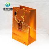 Goldpapiergeschenk-Beutel verwendet für das Verpacken der Lebensmittel und Geschenk-Drucken