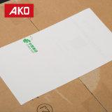Papel termal blanco impermeable de las escrituras de la etiqueta de envío del trazador de líneas del papel cristal de la calidad excelente