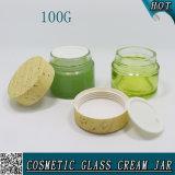 100g esvaziam o frasco de creme cosmético de vidro colorido com tampão de madeira