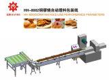 Sistema de alimentación Doroyaki con máquina de embalaje