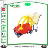 Het Boodschappenwagentje van de Kinderen van de supermarkt met de Zetel van de Baby