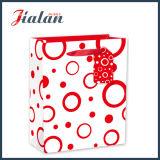 Círculos de papel laminado brillante del arte circundan el bolso de papel diario del regalo de las compras