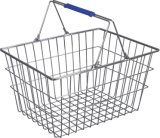L'estetica del supermercato memorizza il cestino di acquisto dorato del collegare del metallo