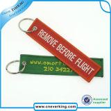 Kundenspezifisches Stickerei-Gewebe Keychain, entfernen vor Flug-Schlüsselkette