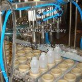 自動びんの詰物およびシーリング機械
