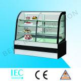 Bolo e congelador do indicador da padaria