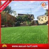 La hierba sintetizada de la hierba de Turquía de la hierba de la alfombra artificial artificial del césped se divierte la estera