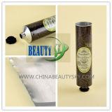 Пробка сливк руки внимательности кожи тела обозначая упаковывая пустая алюминиевая складная