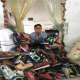 Вторая рука обувает оптом от Китая, используемого ввоза ботинок