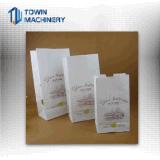 機械ショッピング・バッグを作る正方形の最下の紙袋を入れるロール