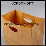 穴のハンドルが付いているクラフト紙袋、カスタマイズされたサイズおよび印刷は歓迎されている
