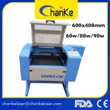 Máquinas de estaca pequenas do laser do CO2 de borracha do papel de vidro para a venda