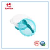 Ciotola d'alimentazione del bambino con la base di aspirazione ed il cucchiaio del sensore