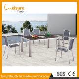 Im Freiengarten-Swimmingpool-Ausdehnungs-Tisch-gesetzte Esszimmer-Möbel