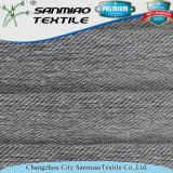 Il filato di stirata del cotone di stile della saia ha tinto il tessuto lavorato a maglia di lavoro a maglia del denim per gli indumenti