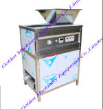 Décollement de la peau des bombardements de l'oignon légumes retrait peller la machine