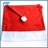 عيد ميلاد المسيح يغطّي كرسي تثبيت [سنتا] كلاوس قبّعة أحمر لأنّ عيد ميلاد المسيح [دكرا]