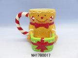 Tazza di caffè di ceramica decorativa di natale con il supporto del biscotto
