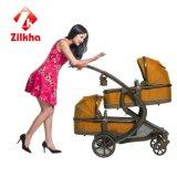 Carrinho de criança de bebê com frame e o Carrycot dianteiro de Carrycot e traseiro