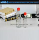 Molho dos pimentões, recipiente de vidro do óleo com tampão plástico