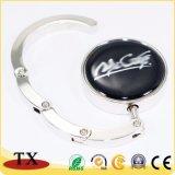 Percha plegable redonda del bolso del metal del regalo de la promoción con la etiqueta engomada