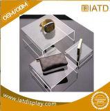 Sauter vers le haut le stand d'exposition inscrit par plastique cosmétique promotionnel acrylique d'étalage de montre