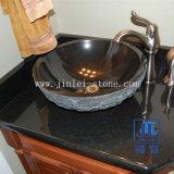 Fregadero de piedra negro de la vanidad del cuarto de baño