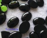 カボション風に宝石類の部分自然で黒いオニックス