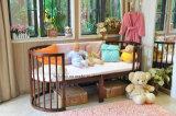 子供の家具の赤ん坊の家具の木の変換可能なまぐさ桶の円形の折畳み式ベッド