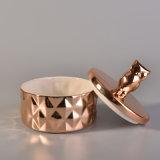 動物のふたが付いている陶磁器のローズの金の蝋燭の瓶