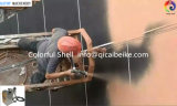 Funcionamento no local da máquina de pedra verdadeira do pulverizador da pintura com pistola