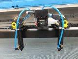 衣類、カートンの工場のためのCCDのカメラ機械が付いているCNCの二酸化炭素レーザーの切断そして彫版機械