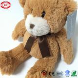 Bruine Klassieke die Mens met Stuk speelgoed van de Teddybeer van het Lint het Leuke wordt gemaakt