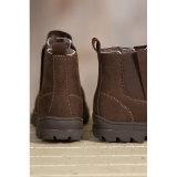 本革の足首は人の冬の偶然靴を起動する