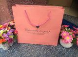 L'impression de couleur conçoivent en fonction du client plus des sacs à provisions de robe de mariage de taille