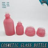 装飾的なガラスビンの製造業者のピンクの楕円のローションのびんおよびクリームの瓶
