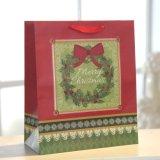 El bolso de Christmasred calza la bolsa de papel